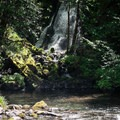 A small pool sits at the base of the falls.- Whispering Falls Swimming Holes