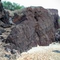 The beach terminates at a vertical rock wall. A quick scramble up a rock ramp gets you to the top.- Pu'u Ola'i / Red Hill