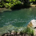Emerald pools below the Snyder Bridge.- Snyder Bridge Swimming Hole, Idanha