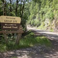 The entrance to Fernview Group Campground from Highway 20.- Fernview Swimming Holes