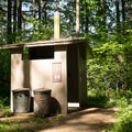Vault toilets in Sharps Creek Recreation Area Campground.- Sharps Creek Recreation Area Campground