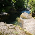 Rocks near the lower pool at Sharps Creek.- Sharps Creek Recreation Area Swimming Hole