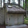 Vault toilets at Baker Bay Campground.- Baker Bay Campground, Dorena Reservoir