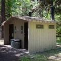 Vault toilet in Salmon Creek Falls Campground.- Salmon Creek Falls Campground