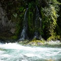 An unnammed tributary to Salmon Creek plunges in.- Salmon Creek Falls Swimming Holes