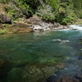 The lower pool has a rock bench for sitting across the river.- North Fork Middle Fork Willamette Swimming Hole 3.5