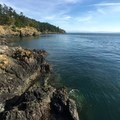 Rocky coast at the end of the grassy day use area.- San Juan County Day Park + Campground