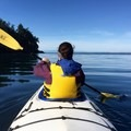 Kayaking out of Smallpox Bay.- San Juan County Day Park + Campground