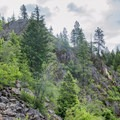 The trail crosses steep rock and scree on the way to the viewpoint at the top.- Highpoint Trail