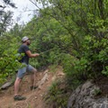 A rope leads to a steep, loose-footing section that can be avoided by staying to the right.- Highpoint Trail