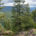 A small glimpse of Lake Pend Oreille on the Highpoint Trail.- Highpoint Trail
