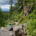 Navigating rock and scree on the Highpoint Trail.- Highpoint Trail