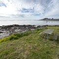 Picnic tables at Yachats Ocean Road Beach.- Yachats Ocean Road State Natural Site