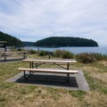 Picnic tables overlooking the bay.- Bowman Bay