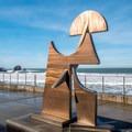 Sculpture on the plaza at Rockaway.- Rockaway Beach