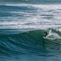 Surfer enjoying the waves at Rockaway.- Rockaway Beach
