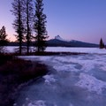 The lake remains frozen in late spring.- Big Lake Snowshoe