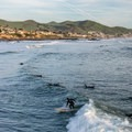 Surfers at Cayucos State Beach.- Cayucos State Beach