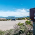 Parking area for the sand spit.- Sand Spit Day Use Area
