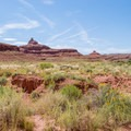 Looking back on the Mexican Hat formation from near the river.- Mexican Hat Rock