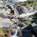Snowmelt streams cascade off of the rocks.- Mount Washington via Tuckerman Ravine Trail