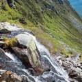 The trail crosses meltwater streams that can be slippery hazards.- Mount Washington via Tuckerman Ravine Trail