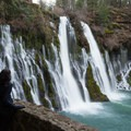 A visitor admires the falls from a breakpoint in the trail.- McArthur-Burney Falls Memorial State Park