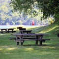 Jensen Point picnic tables and grills.- Jensen Point Park