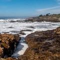 Rocky shoreline.- Arroyo de los Frijoles Beach