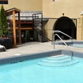 Outdoor pool and hot tub.- Crystal Lodge