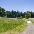 Path winding through the site of old military structures.- Fort Yamhill State Heritage Area
