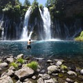A brave swimmer jumps into the cold waters at McArthur-Burney Falls.- McArthur-Burney Falls Memorial State Park