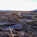 Parking adjacent to the tub, unfortunately, tends to invite campers.- The Rock Tub Hot Springs