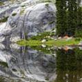 Reflections of camp at the upper lake.- Canyon Creek Lakes
