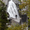 A hiker traverses the slippery rock.- Canyon Creek Lakes