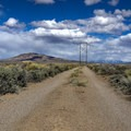 The road to the springs is down a rutted dirt road marked only by a line of power poles.- Bartine Hot Springs