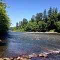 Looking downstream at the North Santiam River from the boat ramp at John Neal Memorial Park.- John Neal Memorial Park Campground