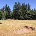 Area with horseshoes, volleyball nets and playground.- John Neal Memorial Park Campground