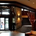 Crystal Lodge's main entrance and grand staircase in the lobby.- Crystal Lodge