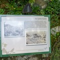Interpretive signs are scattered around the gardens.- The Butchart Gardens
