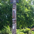 Totem pole carved by Tsartlip and Tsawout First Nations' artists.- The Butchart Gardens