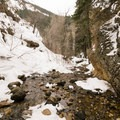 The ungroomed trail ends at the creek.- Hidden Falls Snowshoe