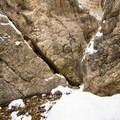 The falls are hidden between these rocks.- Hidden Falls Snowshoe