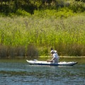 Fishing from kayaks is popular at this lake.- Baum Lake