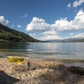 Enjoy beautiful views of the lake from the beach.- Alturas Lake Inlet Day Use Area