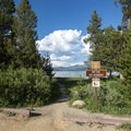 Beach access from the parking area. - Alturas Lake Inlet Day Use Area