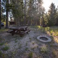 Picnic site and fire pit on the lake.- Alturas Lake Picnic + Day Use Area