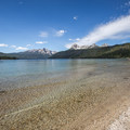 View of the Sawtooth Mountains from the beach in the North Shore Day Use Area.- North Shore Day Use Area