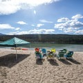 Families claim their beach spots early.- North Shore Day Use Area