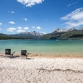 Claim your spot early because this beach fills up on busy weekends.- Redfish Lake Outlet Day Use Area